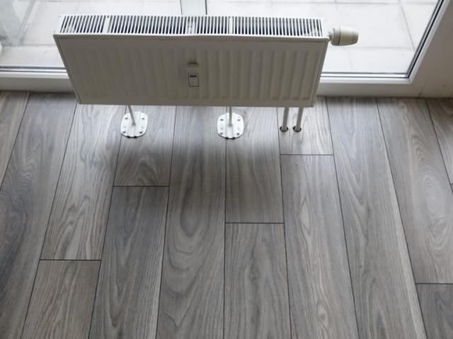 Laminato grindų įrengimas ties radiatoriais